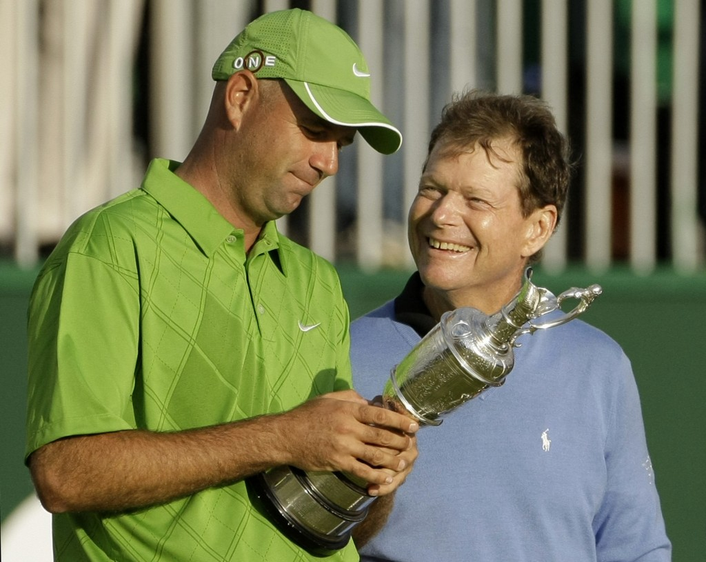 FILE - In this July 19, 2009, file photo, Stewart Cink of the United States, left, holds the trophy as compatriot Tom Watson looks on after Cink won t