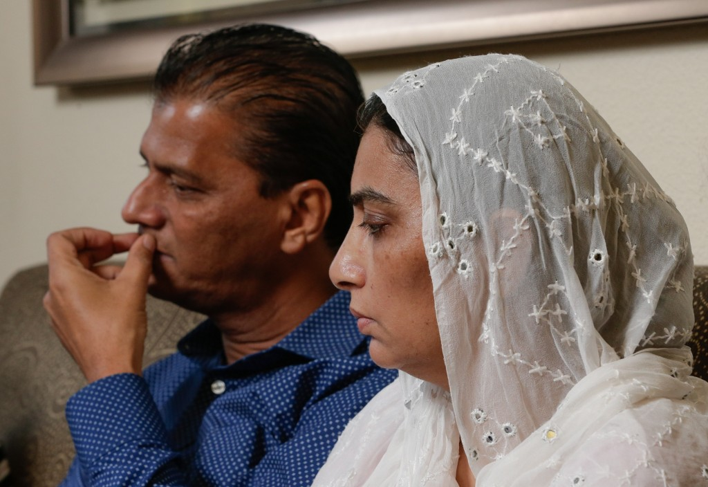 In this Wednesday July 10, 2019 photo, Abdul Aziz, left, and his wife Farah Naz, the parents of Santa Fe High School shooting victim Sabika Aziz Sheik