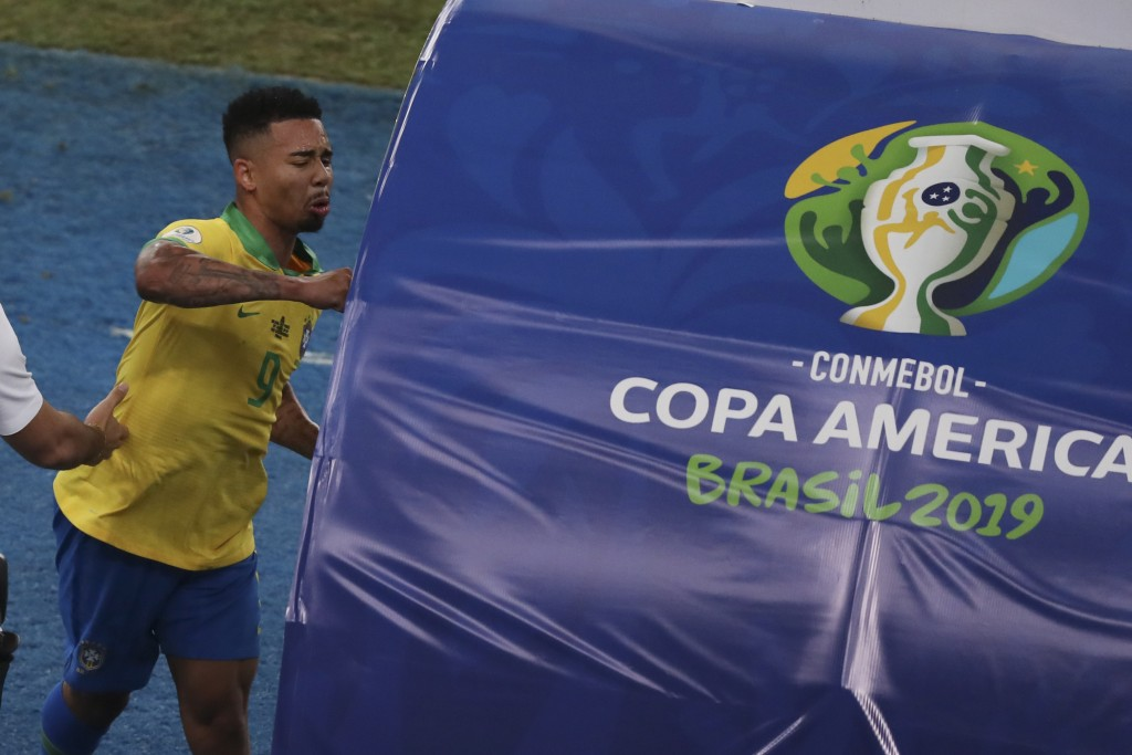 In this Sunday, July 7, 2019 photo, Brazil's Gabriel Jesus punches the bench after referee Roberto Tobar showed him the red card during the final socc