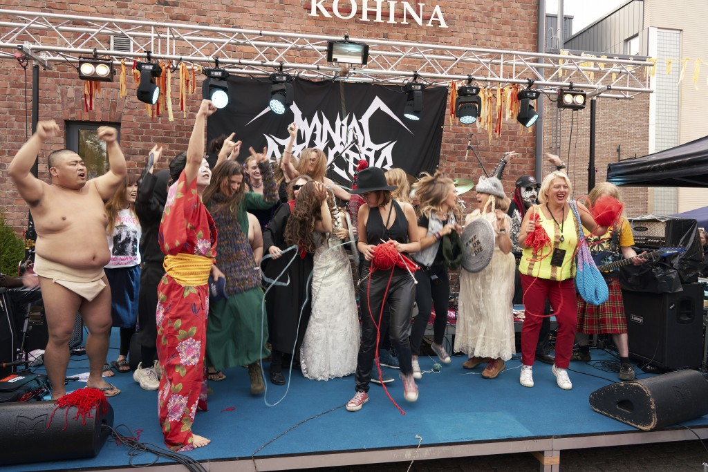The competitors of the first Heavy Metal Knitting world championship react on stage, Thursday, July 11, 2019 in Joensuu, Finland. With stage names suc