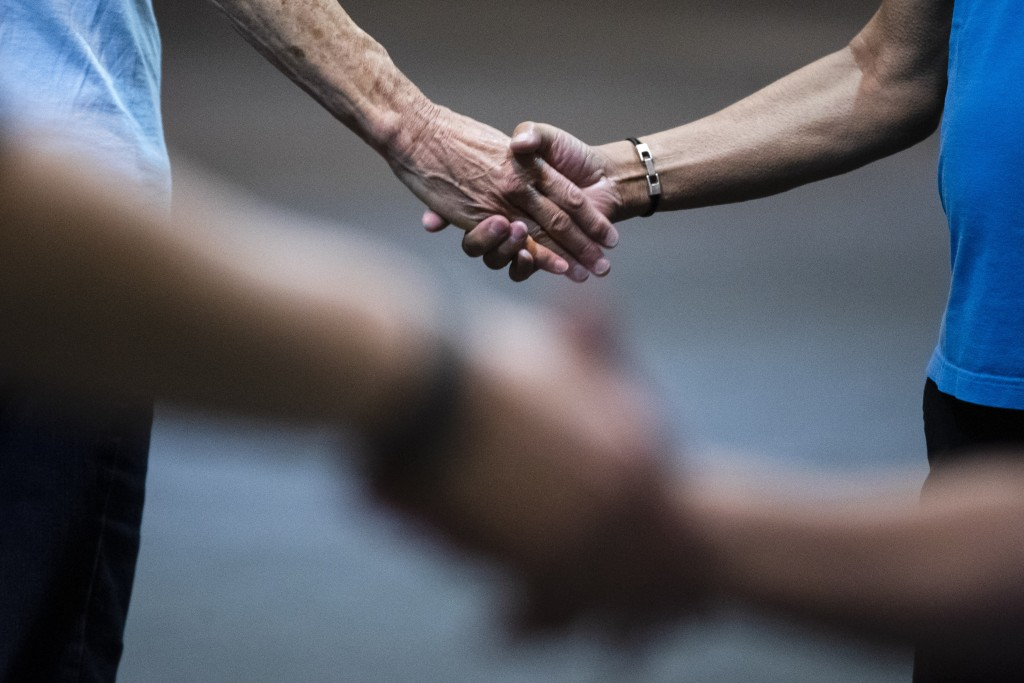 This July 3, 2019 photo shows participants holding hands during the annual International Association of Gay Square Dance Clubs convention in Philadelp
