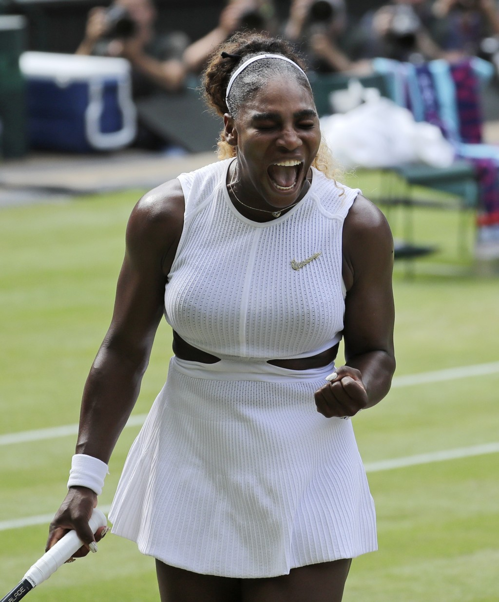 United States' Serena Williams reacts as she plays Czech Republic's Barbora Strycova in a Women's semifinal singles match on day ten of the Wimbledon ...