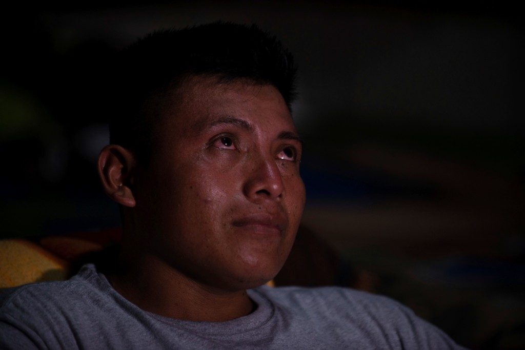 David Xol sits in his one-bedroom home in San Miguel El Limon, 475 kilometers (295 miles) away from Guatemala City, on Sunday, June, 23, 2019. Fourtee