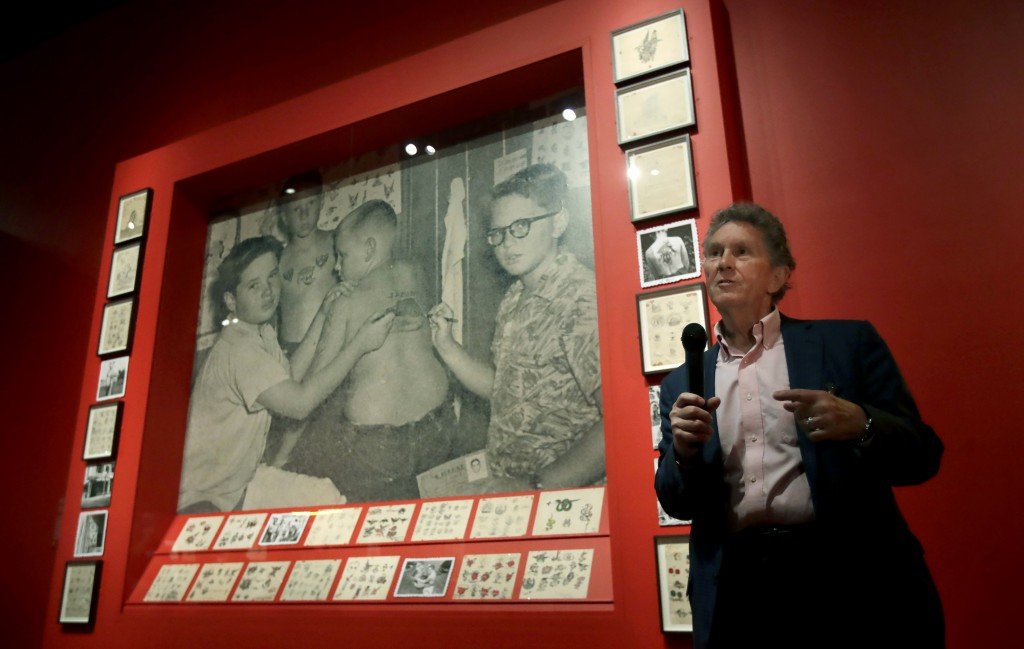 """In this Wednesday, July 10, 2019 photo, Ed Hardy speaks during a media preview of """"Ed Hardy: Deeper than Skin"""" at the de Young Museum in San Francisco..."""