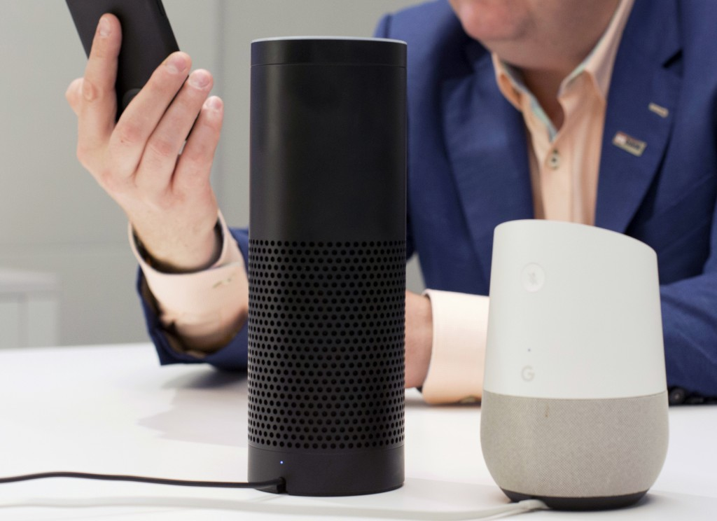 FILE - In this June 14, 2018, photo, an Amazon Echo, center, and a Google Home, right, are displayed in New York. Google contractors are listening to ...