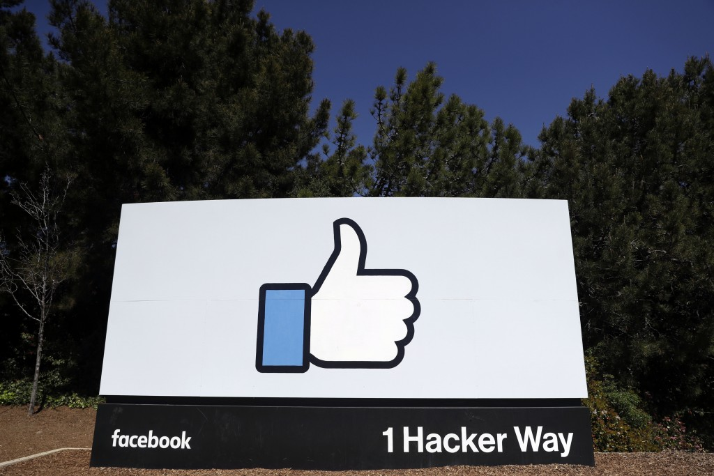 FILE- This March 28, 2018, file photo shows the Facebook logo at the company's headquarters in Menlo Park, Calif. A Wall Street Journal report says th