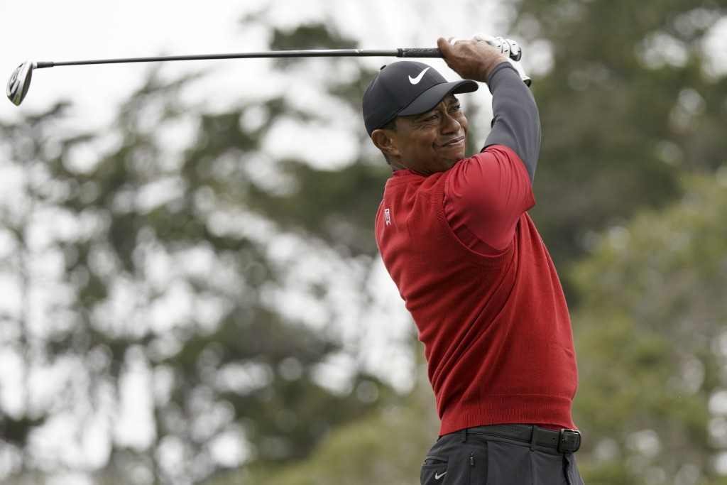 FILE - In this June 16, 2019, file photo Tiger Woods watches his tee shot on the second hole during the final round of the U.S. Open Championship golf...