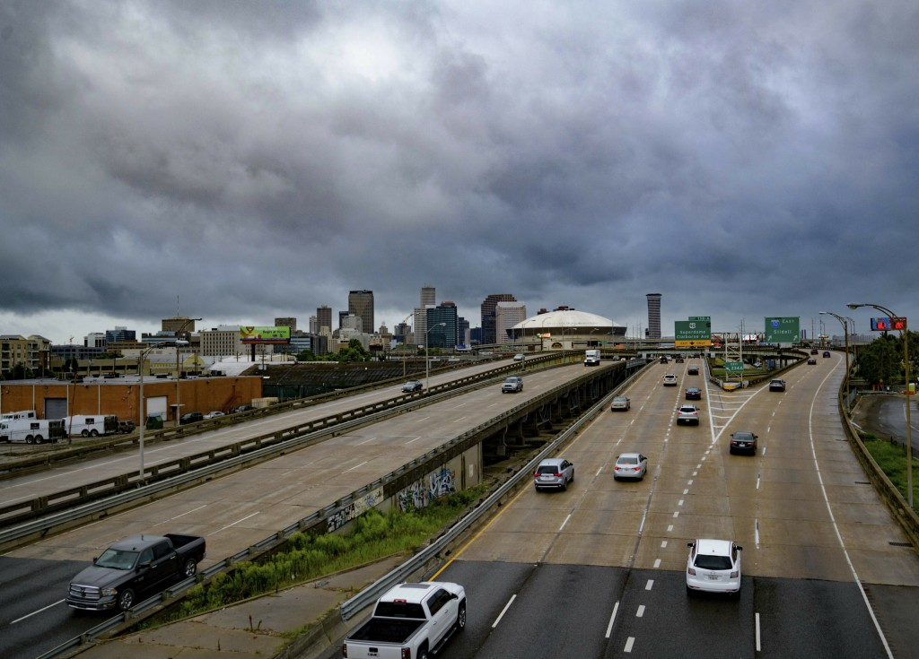 Vehicles make their way on I-10 as bands of rain from Tropical Storm Barry from the Gulf of Mexico move into New Orleans, La., Friday, July 12, 2019.