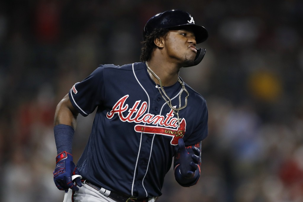 Atlanta Braves' Ronald Acuna Jr. reacts after hitting a home run during the fifth inning of the team's baseball game against the San Diego Padres, Fri