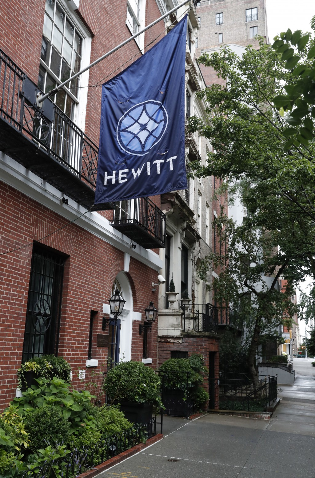 This July 11, 2019, photo, shows the Hewitt School, an all-girls' school located blocks from Financier Jeffrey Epstein's Upper East Side mansion in Ne