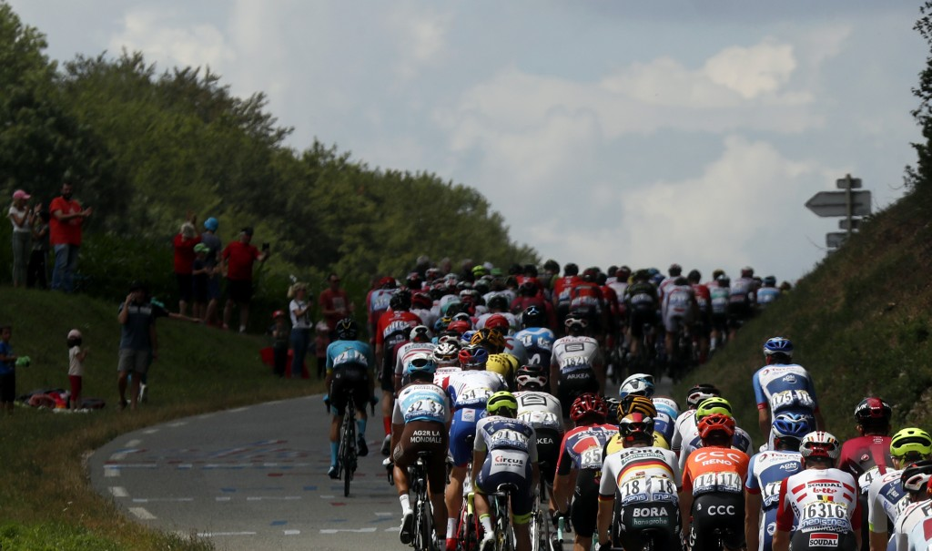 The pack rides during the seventh stage of the Tour de France cycling race over 230 kilometers (142,9 miles) with start in Belfort and finish in Chalo...