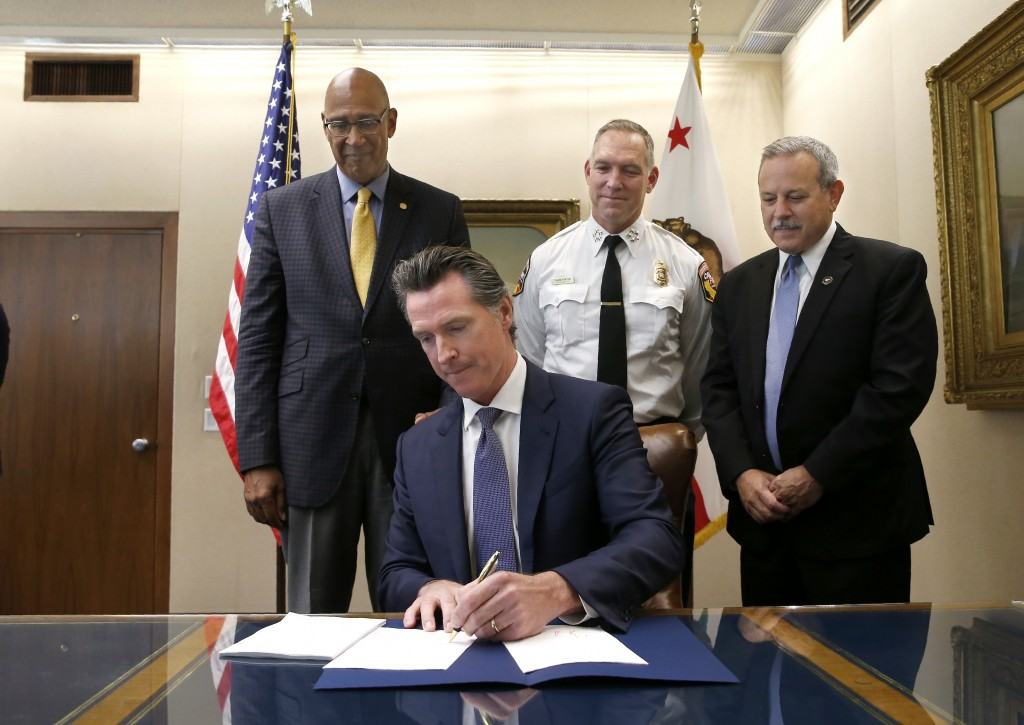 Gov. Gavin Newsom signs a measure aimed at stabilizing the state's electric utilities in the face of devastating wildfires caused by their equipment,