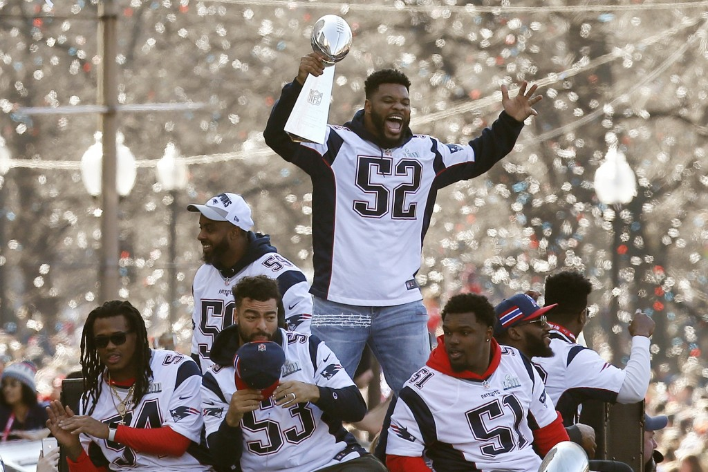 FILE - In this Feb. 5, 2019, file photo, New England Patriots' Elandon Roberts (52) rides a duck boat during the Patriots parade through downtown Bost