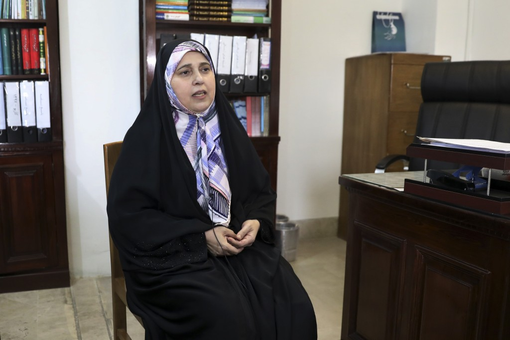 In this Saturday, July 6, 2019 photo, reformist Iranian lawmaker Parvaneh Salahshouri gives an interview to The Associated Press at her parliament off...