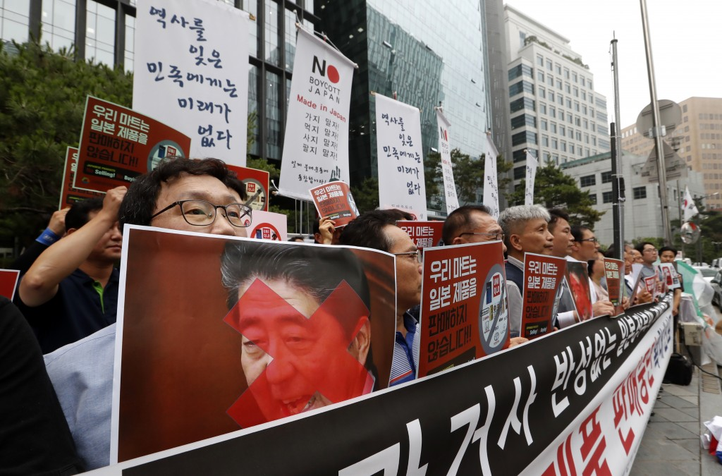 South Korean small and medium-sized business owners stage a rally calling for a boycott of Japanese products in front of the Japanese embassy in Seoul...