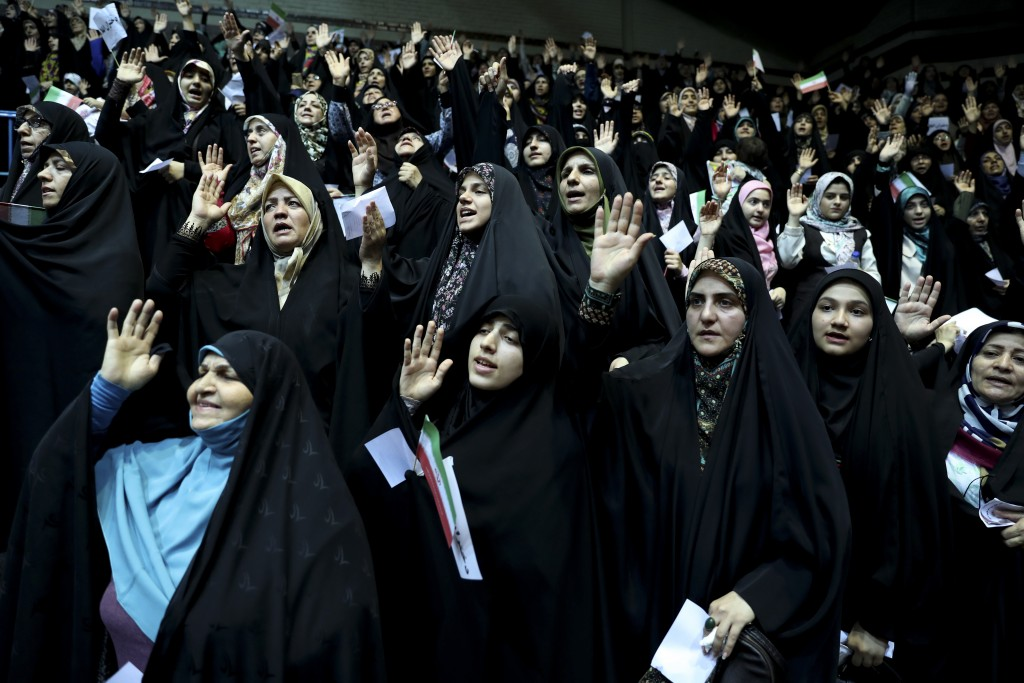 In this Thursday, July 11, 2019 photo, veiled Iranian women attend a ceremony in support of the observance of the Islamic dress code for women, in Teh
