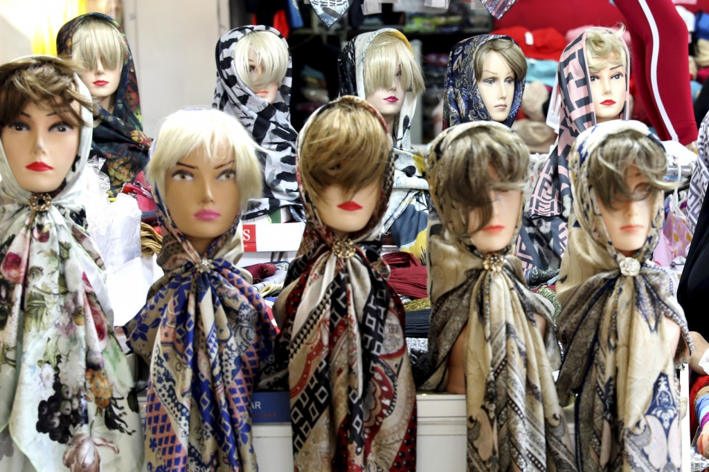 In this Wednesday, July 3, 2019 photo, mannequins with headscarves are placed at a market in downtown Tehran, Iran.  A few daring women in Iran's capi...