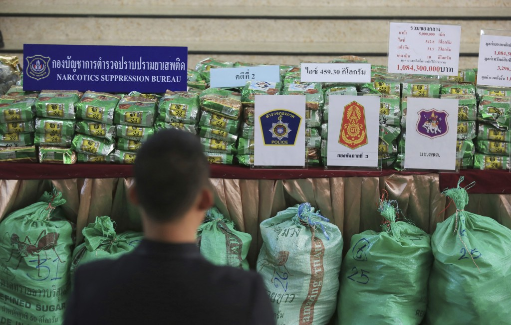 Reporters view packages of methamphetamines on a table during a press conference at Narcotics Suppression Bureau Bangkok, Thailand, Monday, July 15, 2