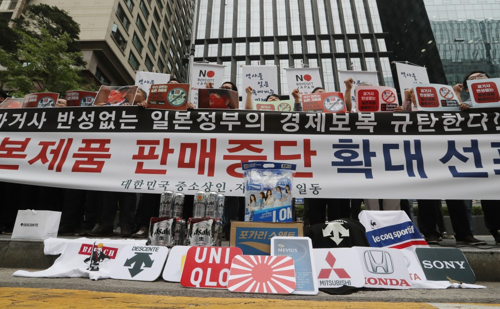 South Korean small and medium-sized business owners stage a rally calling for a boycott of Japanese products in front of the Japanese embassy in Seoul