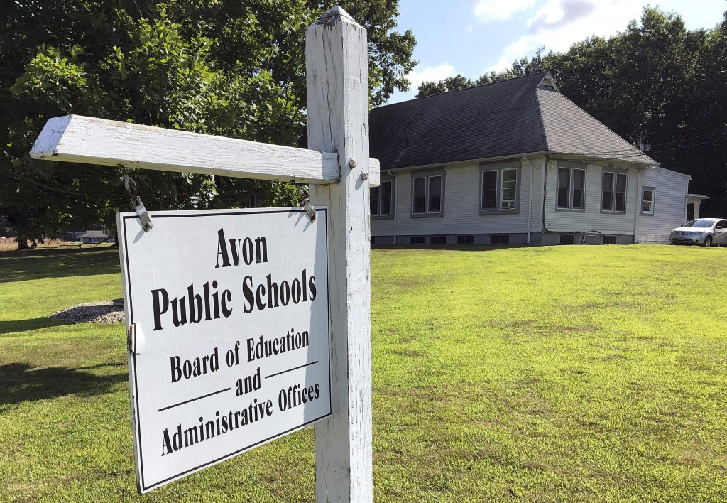 This July 12, 2019, photo shows the board of education offices in Avon, Conn. A denial of a service cyberattack overwhelmed the Avon school district's