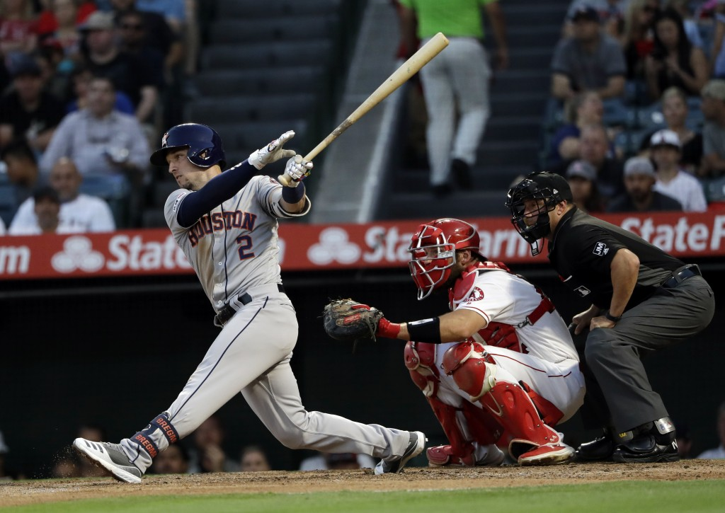 Houston Astros' Alex Bregman (2) drives in a run with a single during the second inning of a baseball game against the Los Angeles Angels, Monday, Jul...