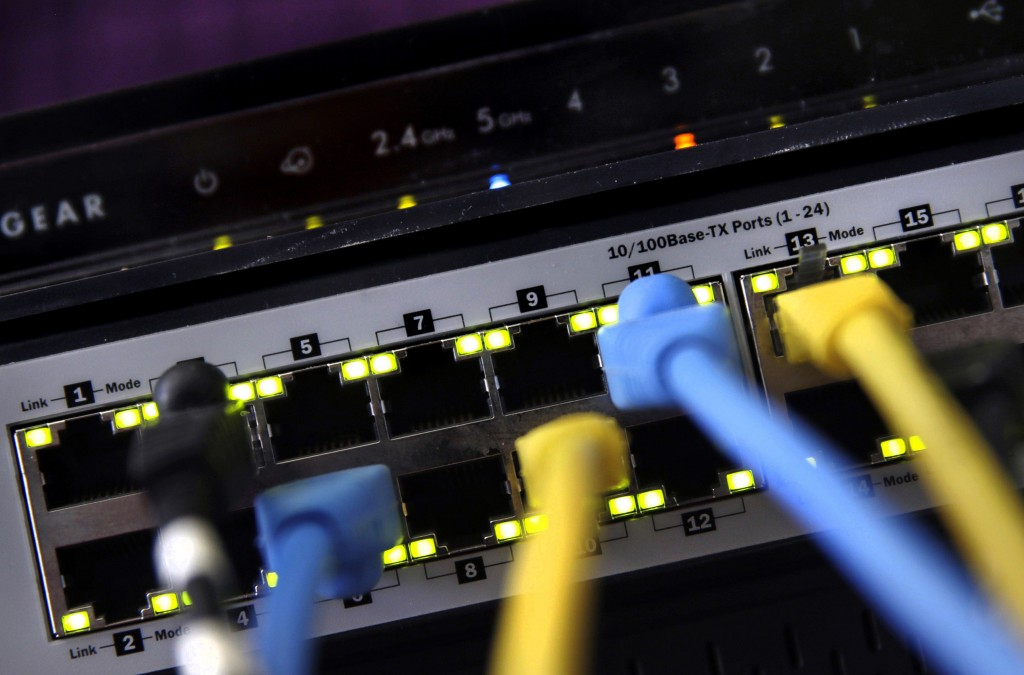 FILE - In this June 19, 2018, file photo, a router and internet switch are displayed in East Derry, N.H. The FBI said cyberattacks have become common ...