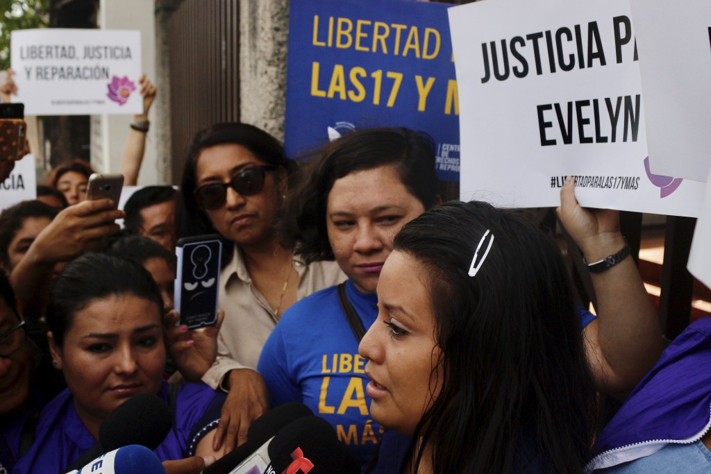 Evelyn Beatriz Hernandez, front, walks past protestors supporting her as she arrives at court for a new trial with a new judge after her 30-year sente...