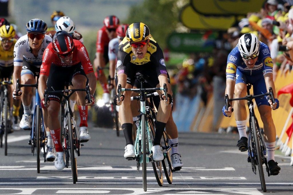 Belgium's Wout Van Aert, center, sprints to win the tenth stage of the Tour de France cycling race over 217 kilometers (135 miles) with start in Saint...