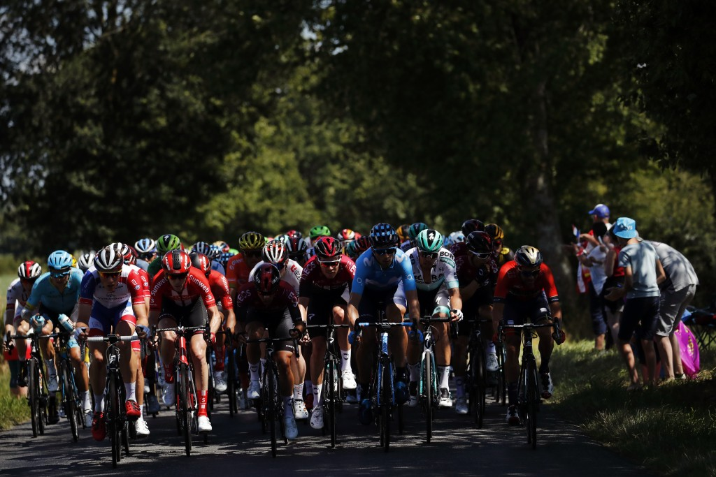 The pack rides during the tenth stage of the Tour de France cycling race over 217 kilometers (135 miles) with start in Saint-Flour and finish in Albi,...
