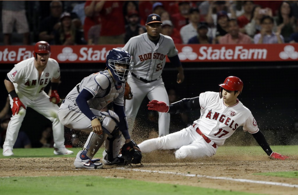 Los Angeles Angels' Shohei Ohtani (17) scores past Houston Astros catcher Robinson Chirinos on a single by Albert Pujols during the fifth inning of a