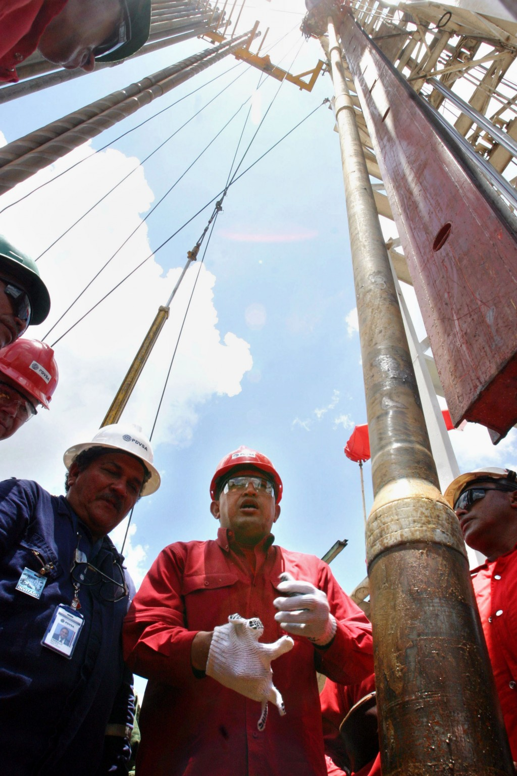 FILE - In this Aug. 10, 2006 file photo, President Hugo Chavez visits oil workers on an oil drill platform in the Orinoco oil belt region in Venezuela...
