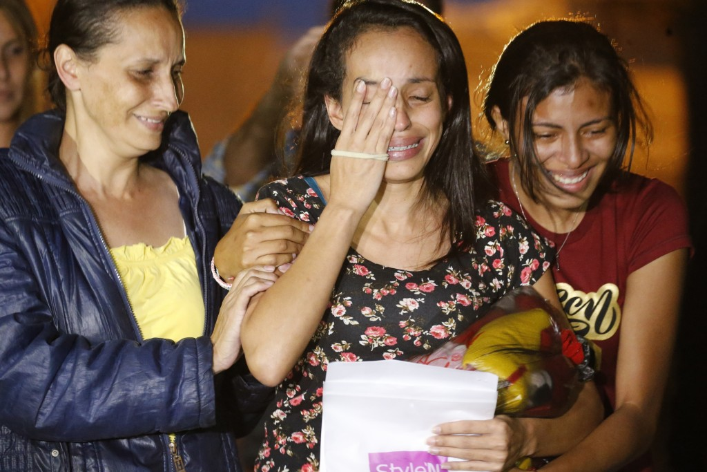 Karen Palacios, center, is helped by family members after she was released from prison at Los Teques on the outskirts of Caracas, Venezuela, Tuesday, ...