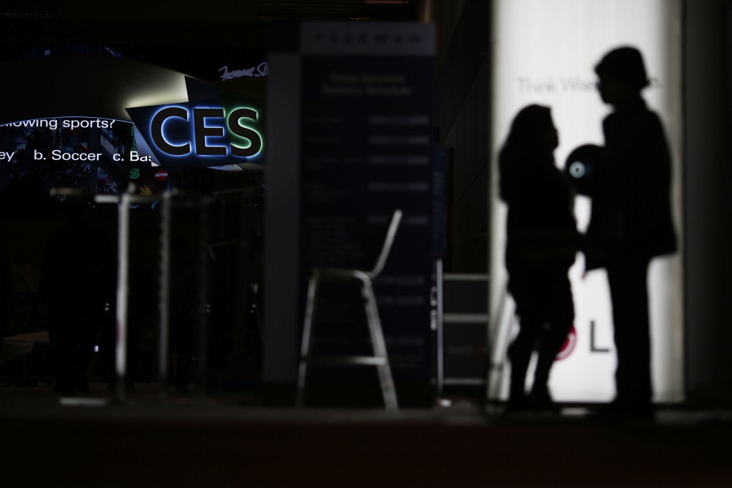 FILE - In this Jan. 5, 2019, file photo people walk around the Las Vegas Convention Center during preparations for CES International in Las Vegas. The