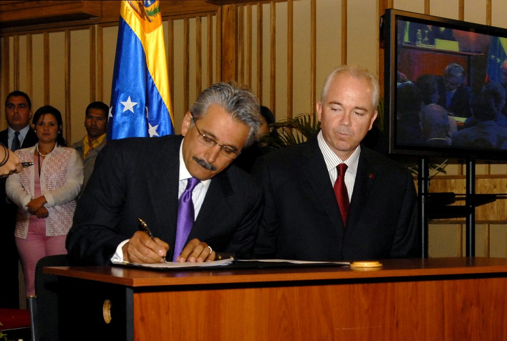 FILE - In this June 26, 2007 file photo, then Chevron's top executive for Latin America Ali Moshiri signs a deal with Venezuela's state oil company Pe...