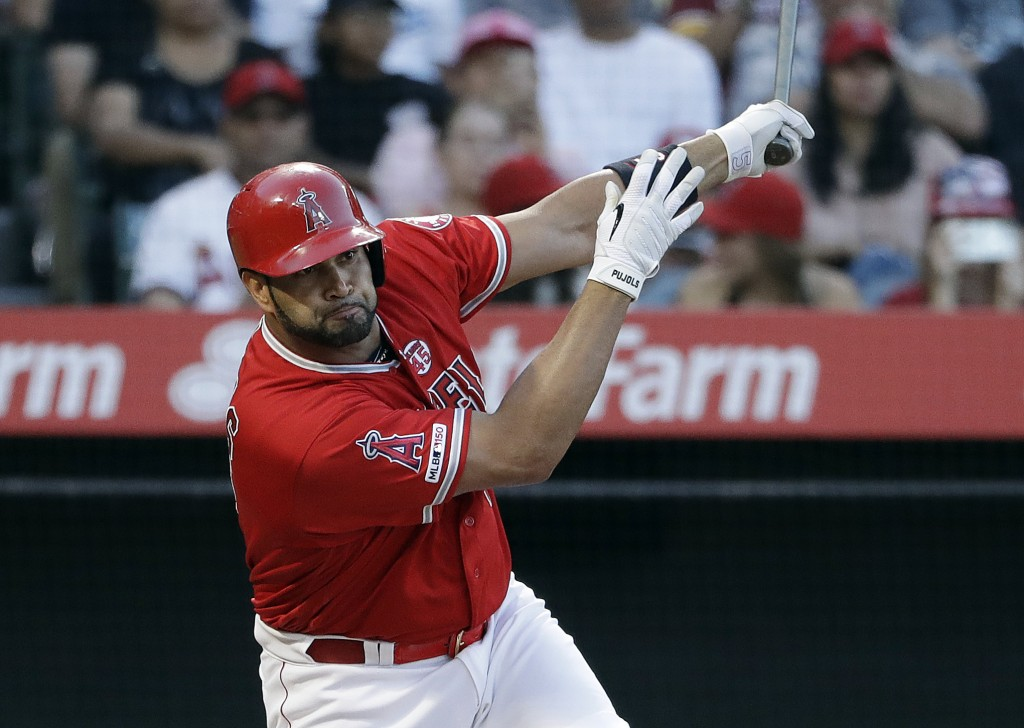 Los Angeles Angels' Albert Pujols drives in three runs with a double during the first inning of a baseball game against the Houston Astros on Tuesday,
