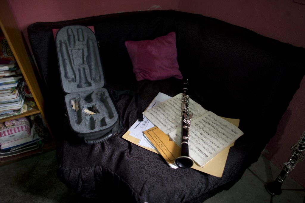 Karen Palacios' Yamaha clarinet still rests atop the sheet music of Mozart's concerto for the instrument that she diligently practiced the night two s...