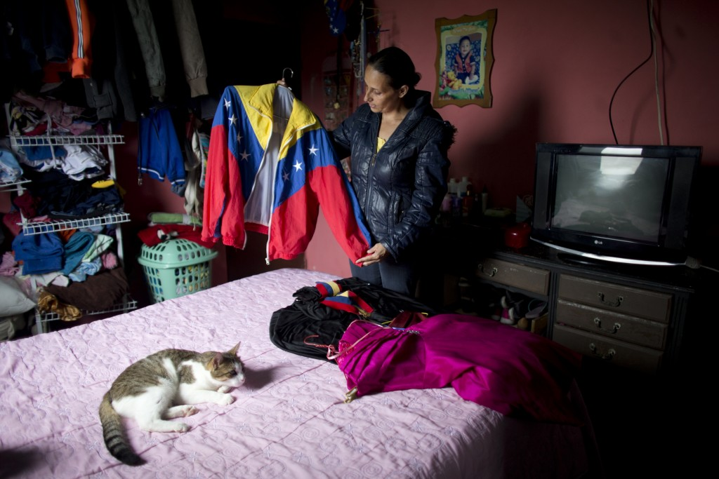 Judith Perez, mother of Karen Palacios, shows the jacket that her daughter wore many times during her performances, in Karen's bedroom in Los Teques i...