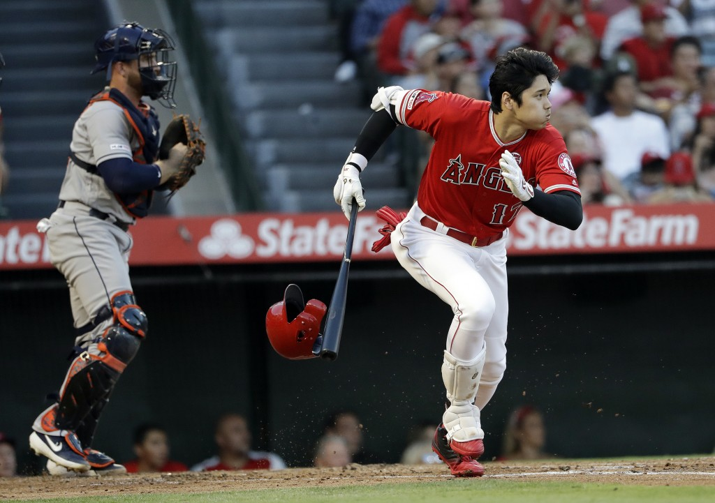 Los Angeles Angels' Shohei Ohtani heads to first on an RBI infield single against the Houston Astros during the first inning of a baseball game Tuesda...
