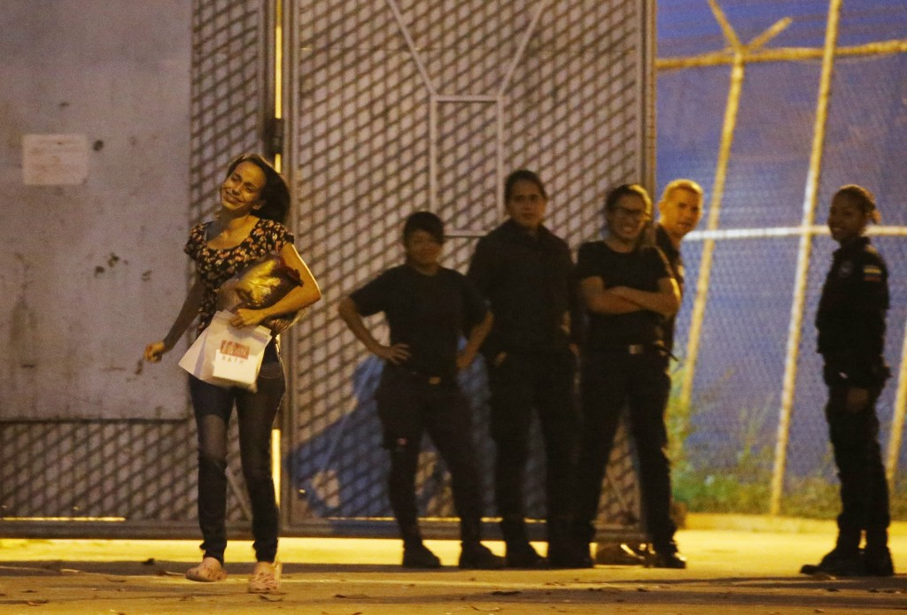 Karen Palacios, left, runs to her family after being released from prison in Los Teques on the outskirts of Caracas, Venezuela, Tuesday, July 16, 2019...