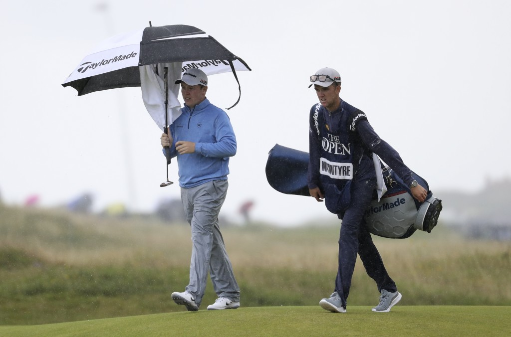 Scotland's Rob Macintyre walks to the 18th green during the first round of the British Open Golf Championships at Royal Portrush in Northern Ireland, ...