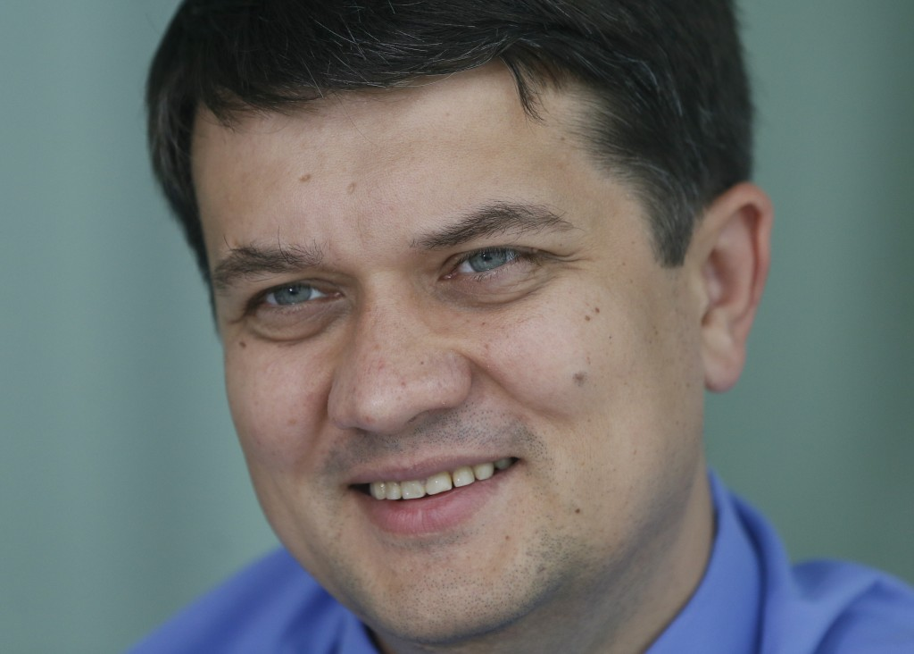 In this photo taken on Friday, July 12, 2019 Dmytro Razumkov, head of the Servant of the People party, smiles, during an interview with The Associated
