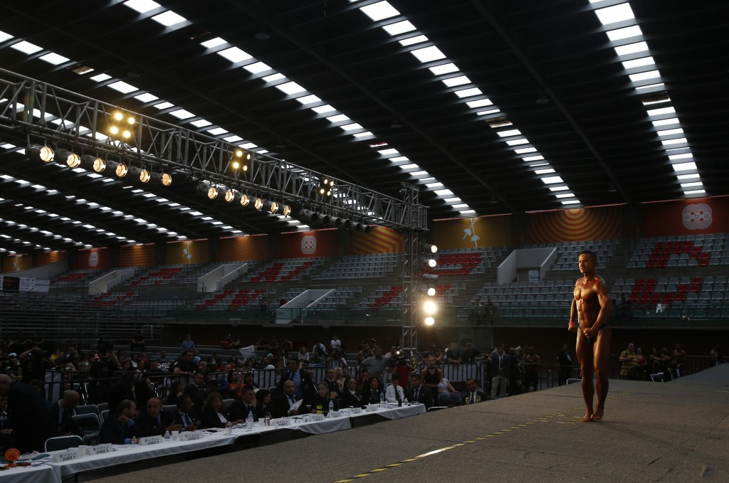 In this July 14, 2019 photo, Mexican bodybuilder Carlos Suarez performs an exhibition routine as training to handle the pressure of competition at the