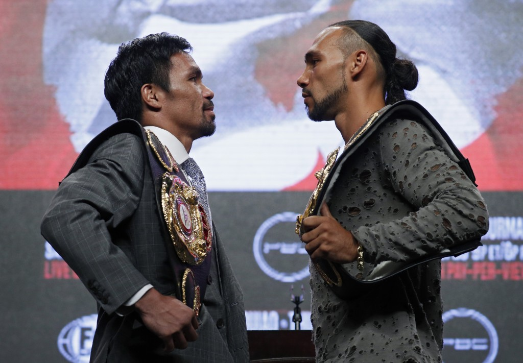 Manny Pacquiao, left, and Keith Thurman pose during a news conference Wednesday, July 17, 2019, in Las Vegas, for their welterweight championship boxi