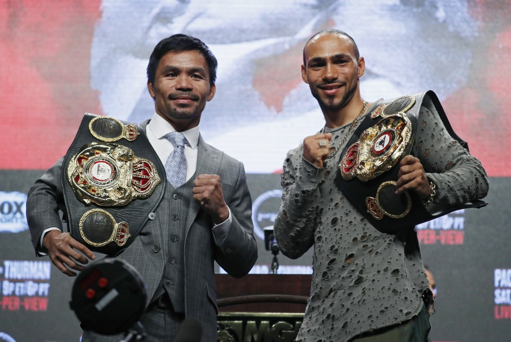 Manny Pacquiao, left, and Keith Thurman pose during a news conference Wednesday, July 17, 2019, in Las Vegas for their welterweight championship boxin...
