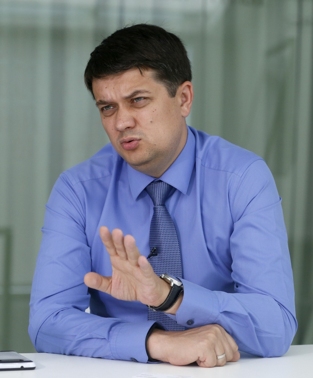In this photo taken on Friday, July 12, 2019 Dmytro Razumkov, head of the Servant of the People party, talks during an interview with The Associated P...