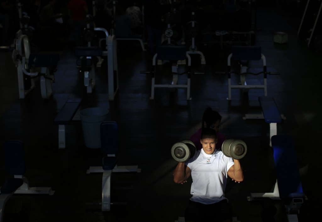 In this June 9, 2019 photo, Mexican bodybuilder Carlos Suarez trains for the upcoming Pan Am Games at the Mexican Olympic Committee facilities in Mexi...