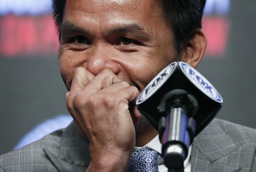 Manny Pacquiao laughs during a news conference Wednesday, July 17, 2019, in Las Vegas. Pacquiao is scheduled to fight Keith Thurman in a welterweight