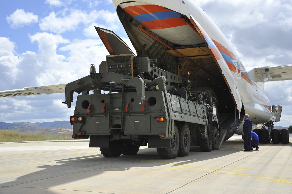 Military vehicles and equipment, parts of the S-400 air defense systems, are unloaded from a Russian transport aircraft, at Murted military airport in
