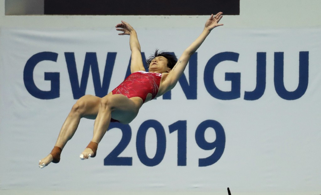 China's Shi Tingmao competes in the women's 3m springboard divin final at the World Swimming Championships in Gwangju, South Korea, Friday, July 19, 2...