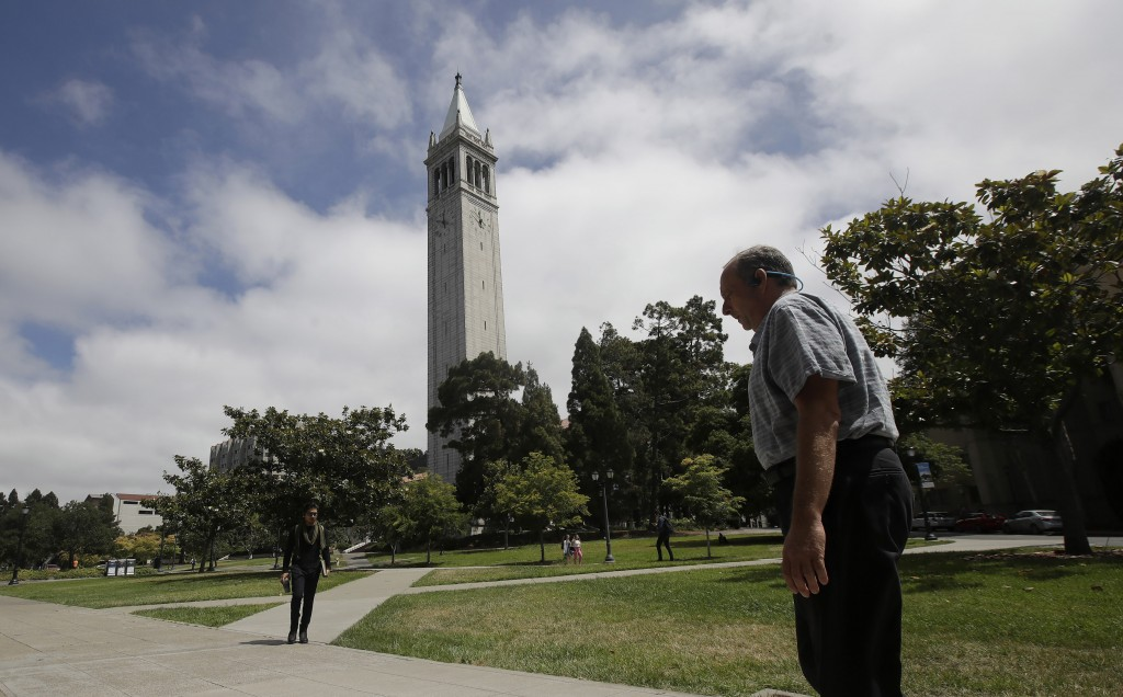 People walk along paths on the University of California at Berkeley campus in front of Sather Tower, also known as the Campanile, in Berkeley, Calif.,...